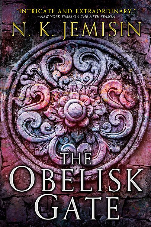 Cover image of THE OBELISK GATE shows stone floral motif above title of book.