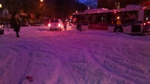stalled bus on snowy street