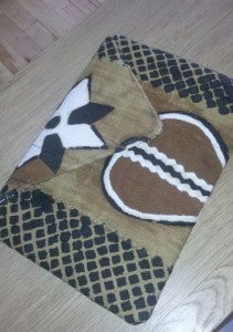case for a macbook air, made from Malian mudcloth. Has a gourd and star design.