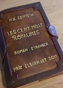 front of a leather book cover inscribed with book's title, author, and Elbakin Prize 2011 in French