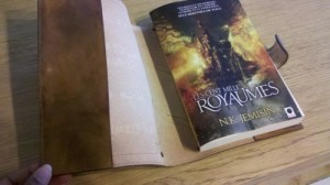 book cover held open to reveal French copy and inner surface