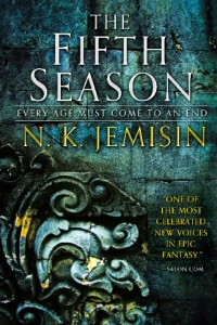 cover of The Fifth Season, a novel by N. K. Jemisin, shows a stone wall and decoration embossed with flaking gold
